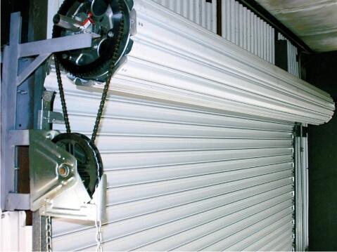 рулонный механизм гаражных ворот